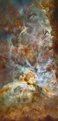 Carina Nebula (Eta Carinae). The binary star or cluster (lower center) is seen as a large white egg shape with dotted lens flares radiating in the cardinal directions. It has a mass estimated at 100-150 of our Suns, and is 4 million times brighter. The image is false color: red is sulfur, green is hydrogen, blue is oxygen. The image is false color: red is sulfur, green is hydrogen, blue is oxygen. This image from NASA/ESA is about 50 light years tall.