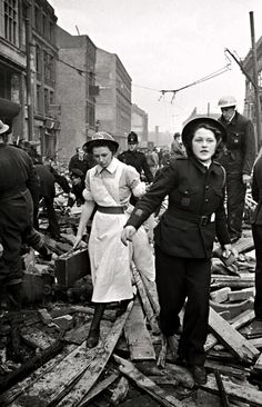 """itsjohnsen: """" Members of the British Ambulance Corps arrive after a V2 rocket strike on London, 1945. Francis Reiss """""""