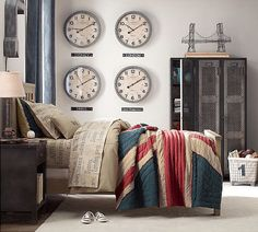 Your little globetrotter will feel right at home in this mature space that can last him well into his teen years. Restoration Hardware Baby & Child's Kenwood bed is finished off with the brand's Union Jack quilt, and a grouping of oversized clocks makes it easy to keep track of friends no matter their time zone! Source: Restoration Hardware Baby & Child