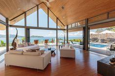 Enjoy the incredible views over the Andaman Sea from the spacious, relaxing living room at Villa Benyasiri, Samsara Villas Phuket.