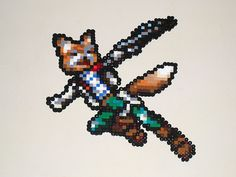 Custom bead sprite of Fox McCloud from Super Smash Bros. I used official artwork from the game for reference but I drew every pixel myself, by hand. Fuse Beads, Perler Beads, Fox Mccloud, Samus Aran, Mario, Melting Beads, Fun Diy Crafts, Perler Patterns, Creative Outlet