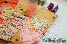 What a great idea! Altered canvas bookmarks by Andrea Gomoll.
