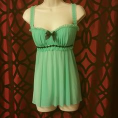 Frederick's of Hollywood babydoll lingerie  (top) Green Frederick's of Hollywood babydoll lingerie  (top only) super cute and sexy in great condition it has a reaaly cute black sequin design right under the bust area ***please make a reasonable offer *** Frederick's of Hollywood Intimates & Sleepwear Chemises & Slips #skirt #dress #pants #shorts #bikini #sunglasses #shoes #lingerie #hair #bag #crochet #tattoo #gold #kiss #sex #sexy #hot #girl #woman #sensual #like #erotic #fashion #lingerie