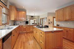 Traditional Light Wood Kitchen Cabinets #91 (Kitchen-Design-Ideas.org) raised panel, black knobs