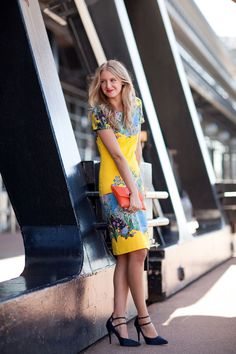 Of course this girl is having fun in this pretty print.   - HarpersBAZAAR.com