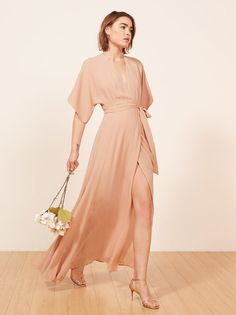 Finally you don't have to lie about liking your bridesmaid dress. This is a v-neck, floor length wrap dress wtih a kimono sleeve.
