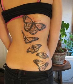 Full back tattoo design with butterflies. This image doesn't belong to seiza.ro and is displayed for inspirational purposes only. For our collection of original tattoo designs visit the 'Original Designs for Tattoos' section.