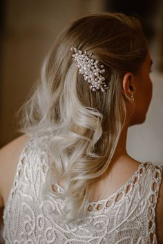 A personal favorite from my Etsy shop https://www.etsy.com/listing/522094333/rhinestone-faux-pearl-bridal-comb