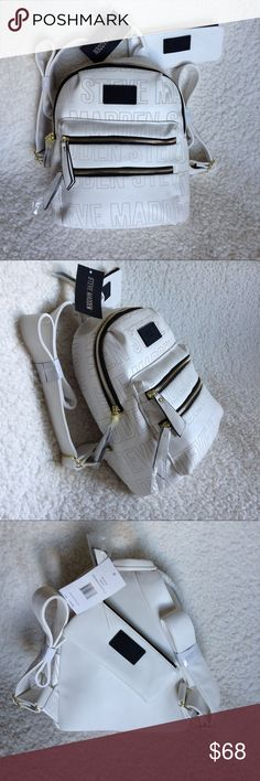 "Steve Madden Mini Benvoy Backpack Very attractive white backpack with perforated name of the designer all over the front and side of the item. For a ""mini"" very spacious inside - enough to hide our little worlds 😉 Material very soft to touch.   - Adjustable straps - Gold tone hardware, high quality - Loop for hanging or hand-carry - zippered closure - fully lined interior (single main compartment with 3 pockets) - 2 outer pockets (front) - 13""H x 10""W x 6""D - Extra zippered pouch for keys…"