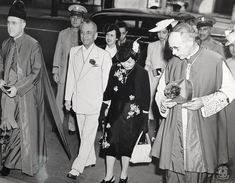 Quezons attend mass at St. Patrick's New YorkPresident Manuel Quezon of the Philippines and Mrs. Quezon are escorted into St. Patrick's Cathedral by Rev. Msg. Joseph F. Flannelly (LEFT), Administrator of the Cathedra and Bishop John F. O'Hara (Right), Military Delegate of the Armed Forces, as they arrive to attend Early Mass today. Behind them are members of the Quezon family and party. Fort Santiago, Intramuros, Walled City, Armed Forces, Timeline, Philippines, Joseph, Cathedral, Military