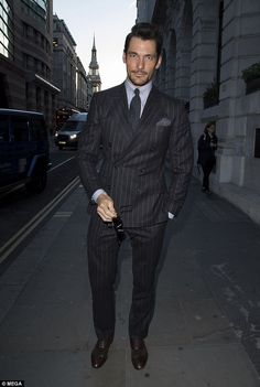 Strike a pose: Model David Gandy cut a suave figure in a pinstriped suit for the event that was hosted by GQ to close London Fashion Week Men