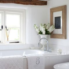 , flowers, ceramics, signature towel, candles, beautiful window molding. love the frame styling ...