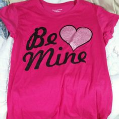 Marielle. Michaels. Nwt:  Be Mine Tee-shirt Nwt. Hot Pink. Color in pictures didn't catch the right color. Still beautiful.  Tag has been ripped but still attached. Tops Tees - Short Sleeve
