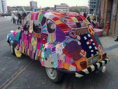 Red Heart Yarns photo of a funky crochet car cover. Yarn Bombing, Hippie Chic, Hippie Style, Hello Kitty Imagenes, Picnic Blanket, Outdoor Blanket, Crochet Car, Art Cars, Fiber Art