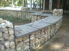 Interesting way to use rock and create a fence/bench -- rebar, rocks, pavers.