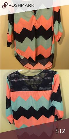 Mid sleeve tunic style shirt Melon mint and blue chevron print tunic shirt. Has a lace panel on the upper back and carrysover to the shoulder. 3/4 length sleeves with buttons. Super cute!! Great to wear with your favorite leggings! Rue 21 Tops Tunics