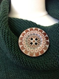 Huge buttons.  Stuck a brooch pin to the back