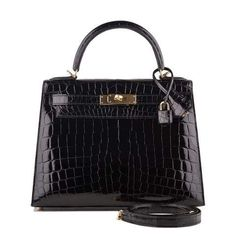9d06efd07a8 Hermes Black Shiny Niloticus Crocodile Kelly Sellier in new or never worn  condition with plastic on hardware.buy authentic Hermes handbags at Madison  Avenue ...