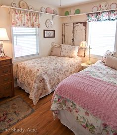 Love the shelf with curtains hanging from it and the door headboards! Notice all the patterns are different..even the curtains.