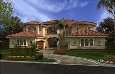 Luxury Home Plans have two stories, six bedrooms, baths plus a cabana, and a two garage. These house plans have a grand covered entrance as well as covered balconies. Columns and arches provide strong curb appeal. These luxury house plans have it all! Coastal House Plans, Luxury House Plans, Mediterranean House Plans, Mediterranean Home Decor, Mediterranean Architecture, Mediterranean Bathroom, Spanish Architecture, Architecture Design, Spanish Style Homes