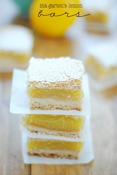 By now it should be abundantly clear that we basically worship at the throne of Ina Garten. We love her show, we love her husband and we love her recipes—notably her desserts. RELATED: 18 Things You Didn't Know About Ina Garten Lemon Desserts, Köstliche Desserts, Lemon Recipes, Sweet Recipes, Dessert Recipes, Lemon Curd Dessert, Lemon Curd Bars Recipe, Lemon Cake Bars, Lemon Cupcakes