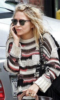 Mary-Kate Olsen // beachy waves, Ray-Ban sunglasses, striped knit, shoulder bag & vintage rings #style #fashion #olsentwins