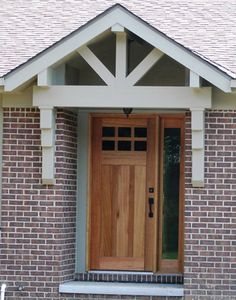 That's the look of the little front entry!     Solid Mahogany craftsmen style door. Covered entry by Justice Homes Inc.