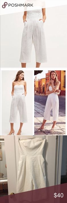 White Eyelet Jumpsuit Midi Reposh! Would keep if I wasn't joining the Peace Corps!! Super cute and got so many compliments, I'm sad to see it go. Fits a size 2-4 Pants Jumpsuits & Rompers
