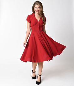 You gotta live in the moment, gals! A gorgeous vintage style dress from Hell Bunny, the Keely dress is 1950s rockabilly radiance incarnate. A woven textured swing, in a classic red midcentury V-neck silhouette, is charming with button up style and round c