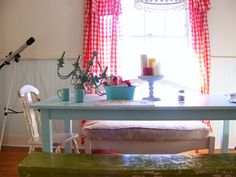 LOVE those red buffalo check curtains and the light blue dining room curtains via Jerusalem Greer's blog
