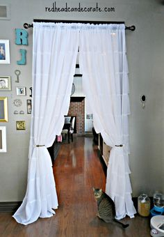 Hanging curtains in kitchen, and over doorways, to save on gas bill. Doorway Curtain, Door Curtains, Hanging Curtains, Kitchen Curtains, Curtain Panels, Gypsy Curtains, Ruffle Curtains, Plywood Furniture, My Living Room