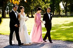 bridal party walking the grounds of tankardstown at a summer wedding
