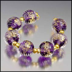 Judith Billig Handmade Lampwork Glass Beads - Gold leaf and purple - Golden Phlox. $36.00, via Etsy.