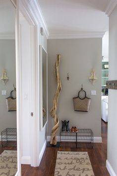 Eunice's Clean & Well-Lit Place — House Tour. Accessories make this entryway, I especially love the large branch.