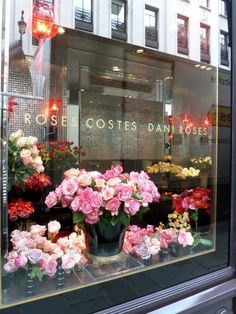 Beautiful flowers in the window of Hotel Costes paris