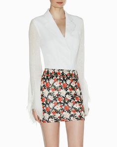 silk blouse, tucked into floral skirt