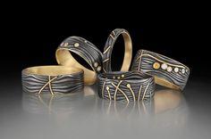 Victoria Moore-/ Rings: Damascus steel, gold, gemstones.  Bagues en acier damassé avec or et pierres precieuses