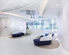 Swarovski UK Headquarters by M Moser Associates, London office design Office Space Design, Modern Office Design, Workplace Design, Office Interior Design, Office Interiors, Bright Office, Office Reception Area, Office Fit Out, Curved Walls