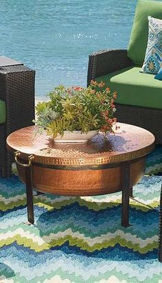 round copper dining table with broken s base design hand hammered