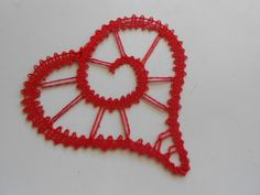 I found a crocheted hearts. So I made pattern for bobbin lace and here is the result. One of the four ♥ https://www.facebook.com/pages/Lena-P/559398950759395?ref=hl