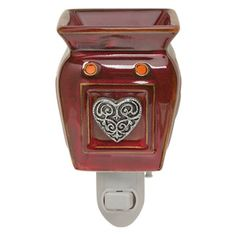 Plug in Heartfelt's ornate silver medallion floats in a glossy red sea of embossed hearts. Great for small spaces with little to no counter space! #scentsy