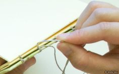 Here's another method of binding your book with an open spine…a chain stitch or also called coptic stitch binding. This is a great method for when you have book covers that are individual boards instead of completely wrapped around the entire journal. You are basically binding all the signatures and covers together with a connected …