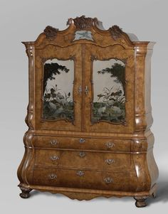 Mirrored cabinet, attributed to Dirk Froger, c. 1764.The cabinetmaker wanted to give this large, heavy cabinet a Rococo shape, but did not succeed in avoiding straight angles and mouldings. Because the silver is marked with a 'year letter', this piece of furniture can be dated rather precisely.