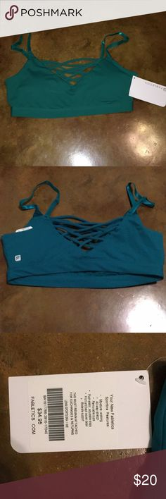 """Fabletics Bra Size Medium. Never worn. Strappy detail in the front and back. Adjustable Straps. Purchased from Fabletics. """"Lenni Sports Bra"""" Greenish/Blue in color. Picture doesn't show well. Fabletics Intimates & Sleepwear Bras"""