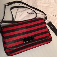 NWT Marc Jacobs Leather Crossbody Handbag Adorable!!  New with tags. Comes with MJ dustbag as shown. Red and black striped leather.  Long leather shoulder strap with silver hardware. Satin interior with MJ logo throughout. Roomy with slide pocket and magnetic closure. Measurements coming soon. No trades. Marc Jacobs Bags Crossbody Bags
