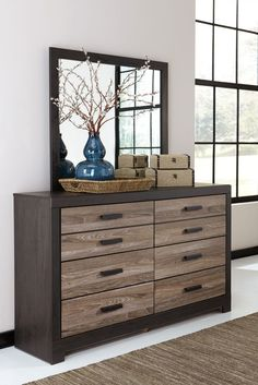 With its unique two-tone treatment of replicated oak grain and metal, harlinton dresser and mirror set is where modern meets vintage in the coolest possible way. beautifully weathered treatment of the