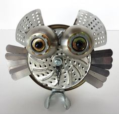 This little owl is the last in a series, as I have run out of these perfectly sized blades to make them out of. This one has eyes made from the bells on top of a vintage alarm clock, brass washers, and teddy bear eyeballs. His horns are made from steamer panels, and his wings are feeler gauges. His beak is a clock hand, his feet are made with a broom hanger. His back is a decorative brass piece from a lamp. Hes the perfect size for a windowsill or bookshelf. He stands 6 inches tall, and 6…