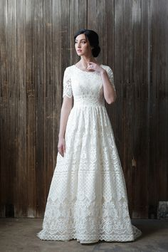 Mon Cheri Modest is a superb soft allover lace A-line modest wedding gown that has cap sleeves under illusion scalloped lace short sleeves, a scalloped gently scooped neckline, a natural waistline. Ideal for your destination wedding. Modest Wedding Gowns, Luxury Wedding Dress, Dream Wedding Dresses, Modest Dresses, Bridal Gowns, Bridesmaid Dresses, Wedding Shot, Prom Dresses, Gown Wedding