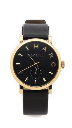 Slim markers detail the round dial on this leather Marc by Marc Jacobs watch, designed with a single subdial that counts seconds.   Marc by Marc Jacobs Leather Baker Watch