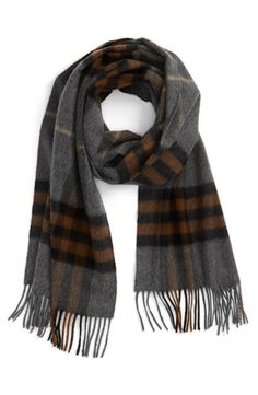 Men's fashion | This brown and grey Burberry scarf will complete any winter outfit.